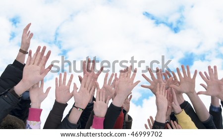poeple hands lifted high to the sky - stock photo