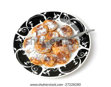 Poffertje with powdered / soft sugar - stock photo