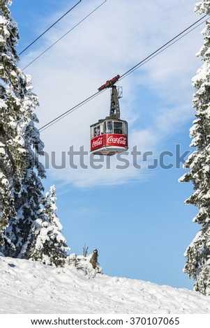 POIANA BRASOV, ROMANIA - JANUARY 24, 2016: Cable car transporting tourists in winter season to the ski slopes in the mountain resort Poiana Brasov