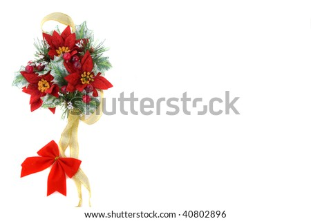 Poinsettia Christmas decoration, nice green and reds color combination, with gold ribbon and red bow. - stock photo