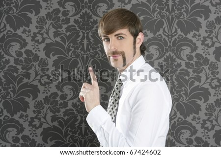 point finger retro businessman salesperson on gray vintage wallpaper - stock photo