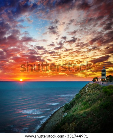 Point Lighthouse at sunset - stock photo