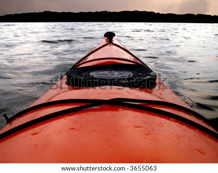 Point of view from kayak cockpit. - stock photo