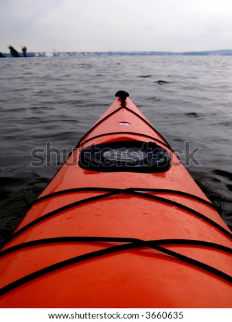 Point of view from kayak cockpit, portrait orientation. - stock photo
