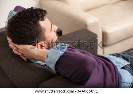Point of view of a man relaxing and laying back on a couch at home