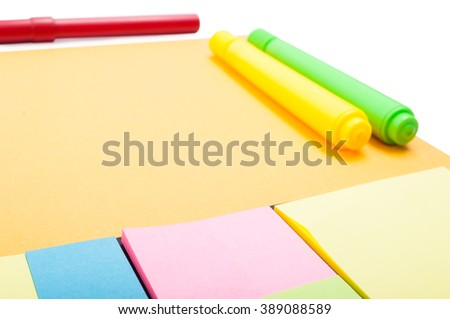 Point of view of blank set of sticky notes on desktop with colourful markers - stock photo