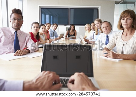 Point Of View Shot Of Businesspeople Around Boardroom Table - stock photo