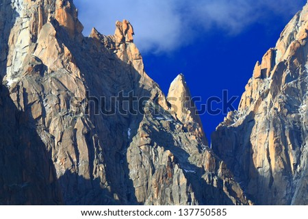 Pointed cliffs and white clouds, Chamonix, France - stock photo
