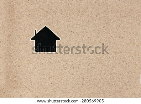 Pointer, ads board in the form house  in the sand, can be used as background - stock photo