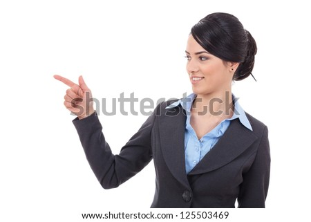 Pointing and looking to the side. Casual young business woman looking, pointing and smiling at copy space. - stock photo