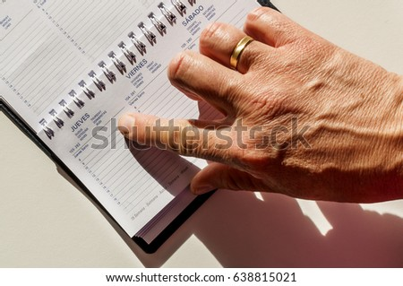 pointing at the diary, finger point