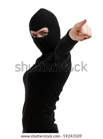 pointing female thief in black clothes and balaclava - stock photo