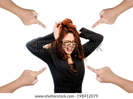 Pointing fingers at stressed out A frustrated Asian woman who is screaming out loud and pulling her hair.isolated on white background - stock photo