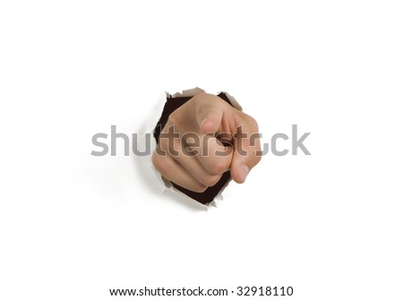 Pointing hand breaking through white wall - stock photo