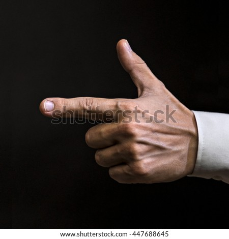 Pointing male hand on black background