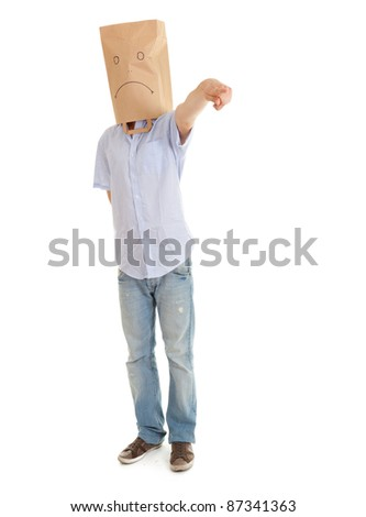 pointing man with sad ecological paper bag on head, full length - stock photo