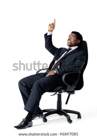 pointing office chair businessman isolated on white - stock photo