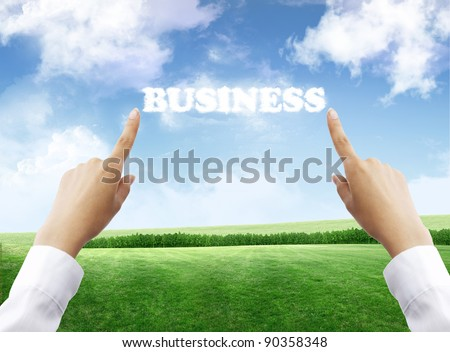 pointing on the business cloud - stock photo