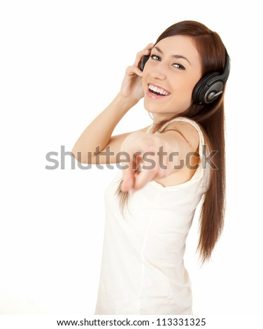 pointing on you casual girl in headphones, white background - stock photo