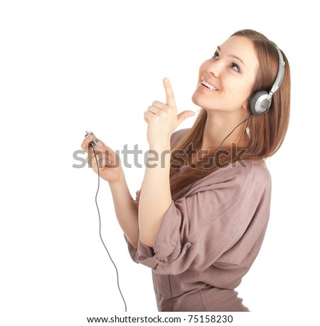 pointing smiling girl in headphones and MP3 player - stock photo