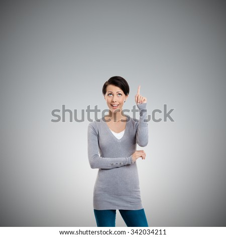 Pointing up hand gesture, isolated on grey - stock photo