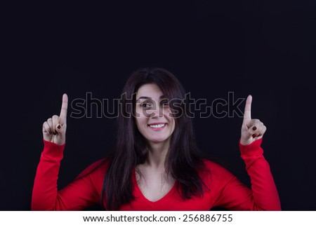 Pointing up Happy excited energetic woman .Portrait of cheering beautiful young women.Facial expression. - stock photo