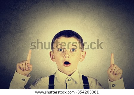 Pointing up smiling  little boy isolated over white background. - stock photo