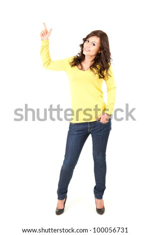 pointing up smiling teenage girl, full length, white background