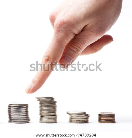 Pointing with finger at the stock of coins