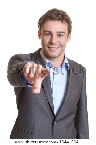 Pointing young businessman - stock photo