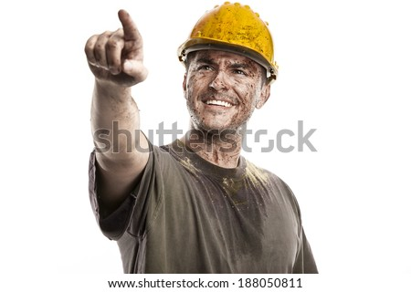 pointing young dirty Worker Man With Hard Hat helmet isolated on White Background - stock photo
