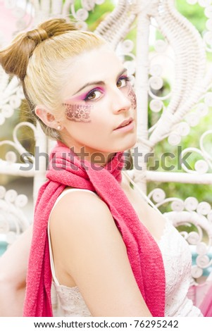 Poised Glamour Model Girl In 20s With Blond Hair In A Bow Wearing A Pink Scarf In A Fashion Glamour Cosmetics Or Makeup Picture - stock photo