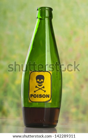 Poison bottle with label - stock photo