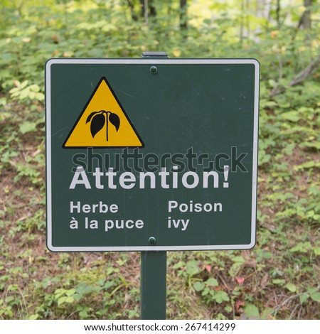 Poison Ivy Warning sign in a forest, Manoir-Papineau National Historic Site, Montebello, Quebec, Canada - stock photo