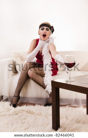 Poisoned wine. Beautiful young woman in red choking - stock photo