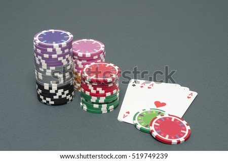 poker aces and chips on the table