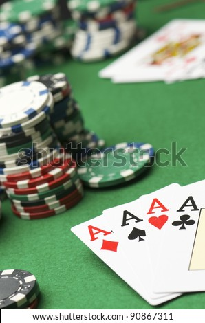 poker aces and gambling chips  stacked on a table