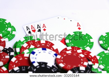 Poker aces on white table with colored chips