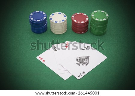 poker and chips on casino table - stock photo