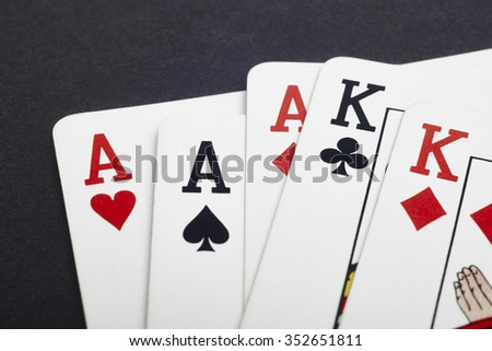 Poker card game with aces and kings full. Black background. Horizontal - stock photo