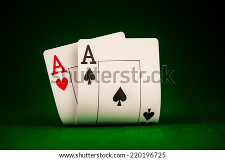 Poker card on the table on the green baize - stock photo