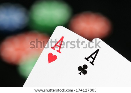 Poker cards and casion chips in front of a black background - stock photo