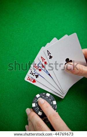 Poker cards and female hand betting in the background