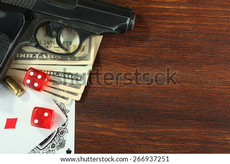 poker cards and handgun - stock photo