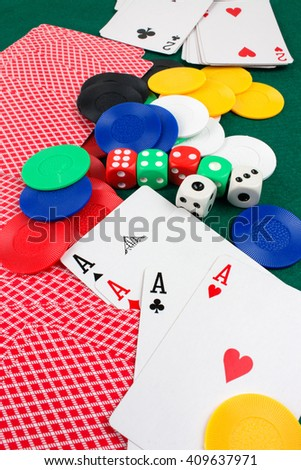 Poker Cards, Dices and Chips on Gambling Table.