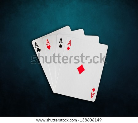 Poker cards on blue background - stock photo