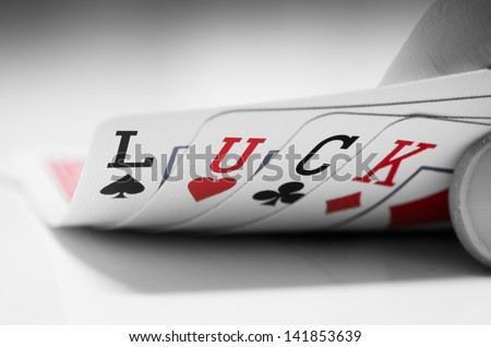 Poker cards with the letters L, U, C, K written on them. - stock photo