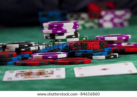 Poker chips and cards in a Texas hold 'em game.