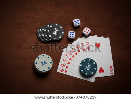 Poker chips and generic playing cards. Courts for poker chips and dice on table
