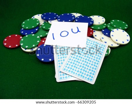 Poker Chips, Cards and IOU - stock photo